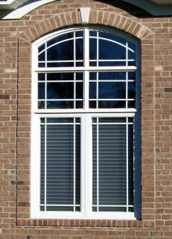 Legacy Twin Casement Window With Prairie Grids And Twin Arched Transoms.